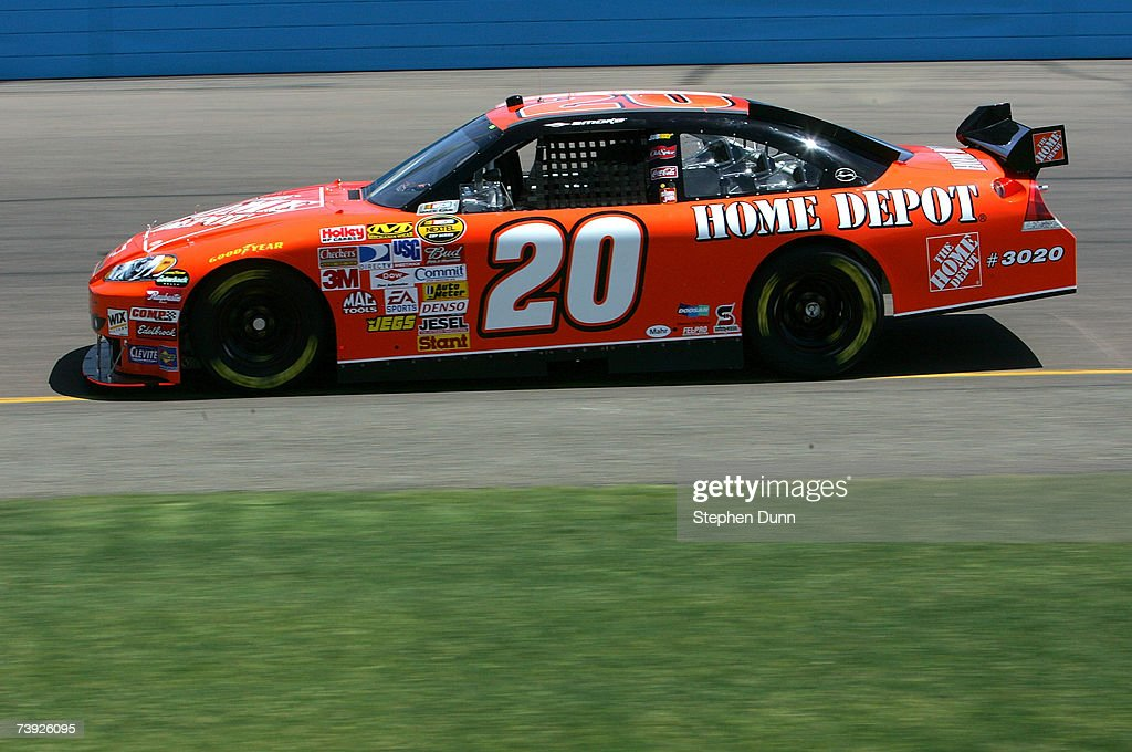 Tony Stewart driver of the The Home Depot Chevrolet drives during practice for the NASCAR Nextel Cup Series Subway Fresh Fit 500 at Phoenix...