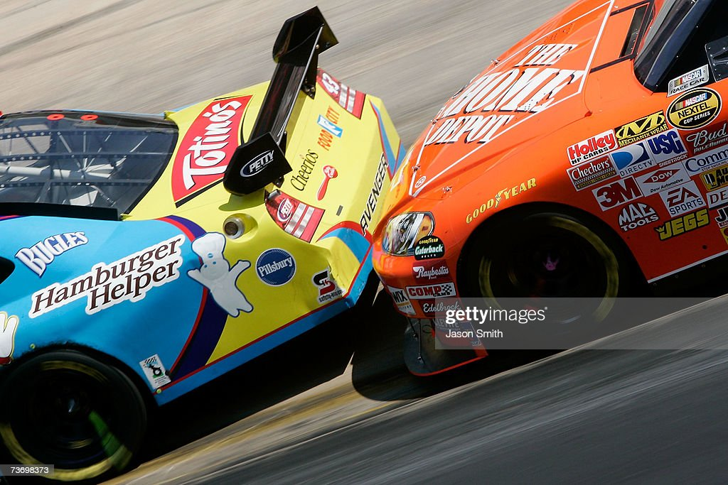 Tony Stewart driver of the The Home Depot Chevrolet pushes Bobby Labonte driver of the Betty Crocker Dodge during the NASCAR Nextel Cup Series Food...