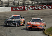 Tony Stewart drives into the fourth turn with Robby Gordon during practice Saturday October 18 2003 at the NASCAR Subway 500 at Martinsville Speedway...