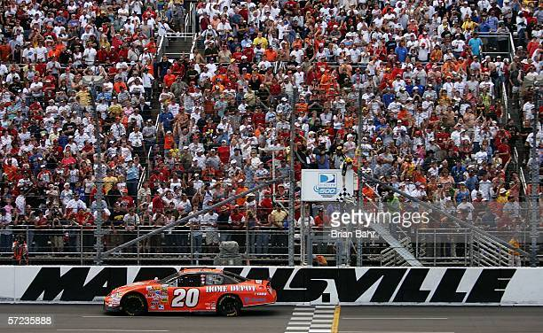 Tony Stewart drives the Home Depot Chevrolet across the finish line to win the NASCAR Nextel Cup Series DirectTV 500 on April 2 2006 at the...