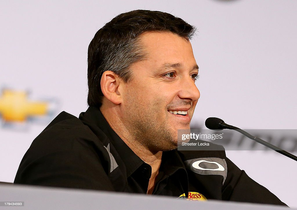 <a gi-track='captionPersonalityLinkClicked' href=/galleries/search?phrase=Tony+Stewart+-+Race+Car+Driver&family=editorial&specificpeople=201686 ng-click='$event.stopPropagation()'>Tony Stewart</a>, NASCAR Sprint Cup Series driver and co-owner of Stewart-Haas Racing, speaks to the media in his first appearance since his sprint car accident at Stewart-Haas Racing on September 3, 2013 in Kannapolis, North Carolina.