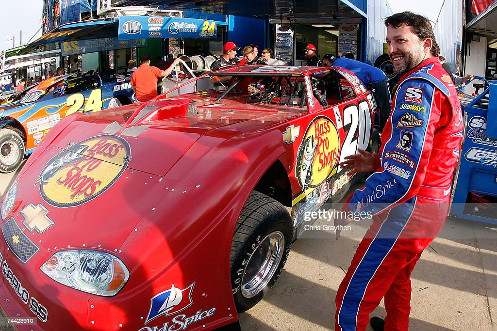 <a gi-track='captionPersonalityLinkClicked' href=/galleries/search?phrase=Tony+Stewart+-+Race+Car+Driver&family=editorial&specificpeople=201686 ng-click='$event.stopPropagation()'>Tony Stewart</a> smiles before driving in the Nextel Prelude to the Dream on June 6, 2007 at Eldora Speedway in New Weston, Ohio.