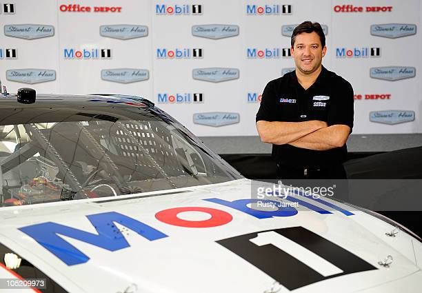 Tony Stewart StewartHaas Racing's driver/owner poses for pictures to announce Mobil 1 as his coprimary sponsor with Office Depot beginning in 2011 at...