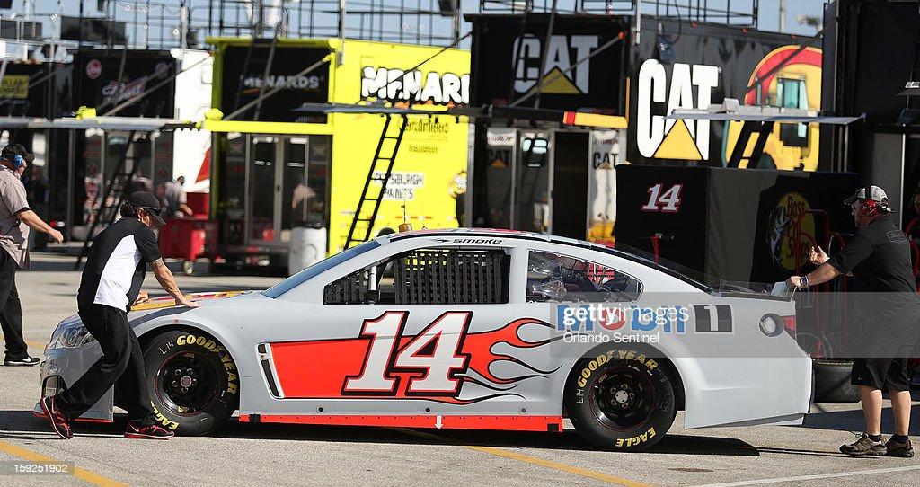 Tony Stewart's crew pushes his car in the garage area during NASCAR Sprint Cup Series Preseason Thunder at Daytona International Speedway in Daytona Beach, Florida, Thursday, January 10, 2013.