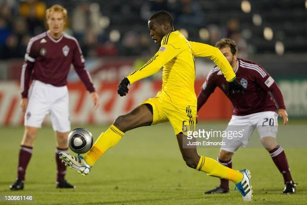 Tony Tchani of the Columbus Crew controls the ball in front of the Colorado Rapids defense during the first half at Dick's Sporting Goods Park on...
