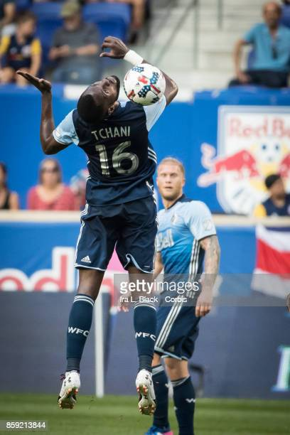 Tony Tchani of Vancouver Whitecaps FC heads the ball during the MLS match between New York Red Bulls and Vancouver Whitecaps FC at the Red Bull Arena...