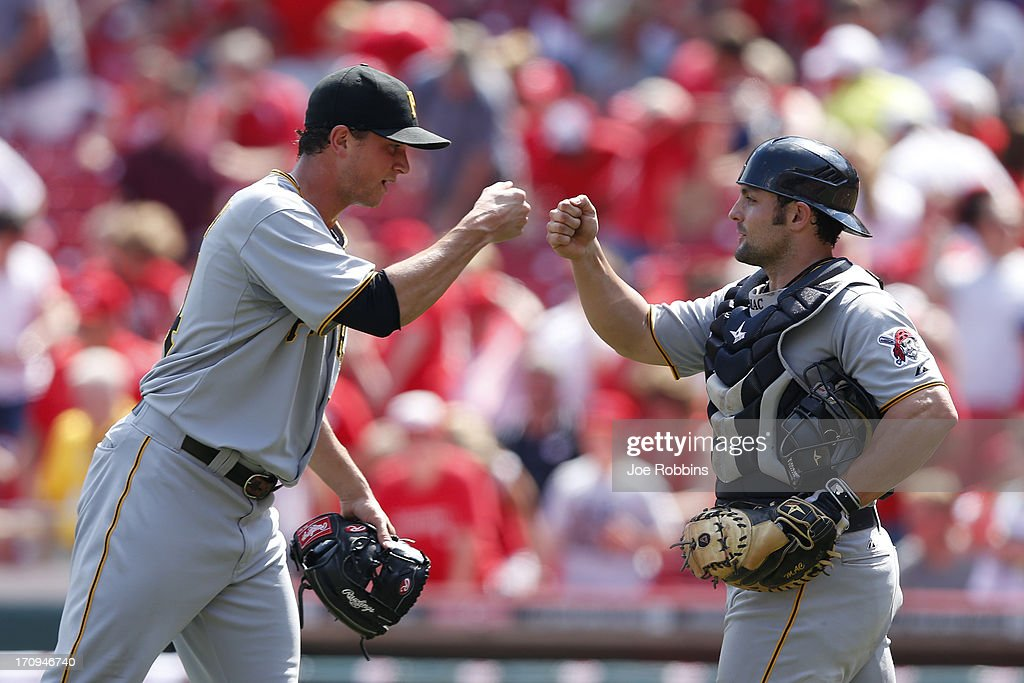 Tony Watson #44 and <a gi-track='captionPersonalityLinkClicked' href=/galleries/search?phrase=Michael+McKenry&family=editorial&specificpeople=4949028 ng-click='$event.stopPropagation()'>Michael McKenry</a> #19 of the Pittsburgh Pirates celebrate after the game against the Cincinnati Reds at Great American Ball Park on June 20, 2013 in Cincinnati, Ohio. The Pirates won 5-3.