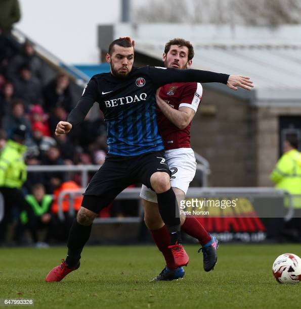 Tony Watt of Charlton Atheltic attempts to control the ball under pressure from Jak McCourt of Northampton Town during the Sky Bet League One match...
