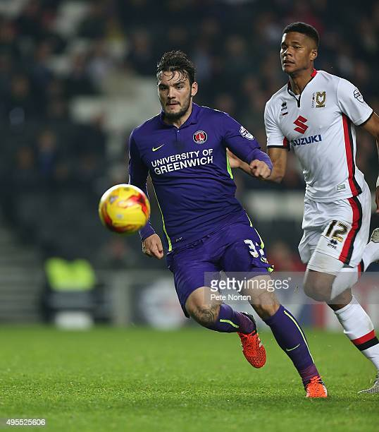 Tony Watt of Charlton Athletic moves forward with the ball away from Jordan Spence of Milton Keynes Dons during the Sky Bet Championship match...