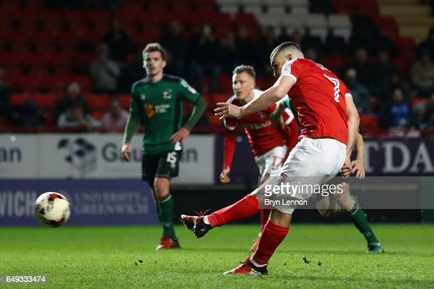 Tony Watt of Charlton Athletic scores from the penalty spot during the Sky Bet League One match between Charlton Athletic and Scunthorpe United at...