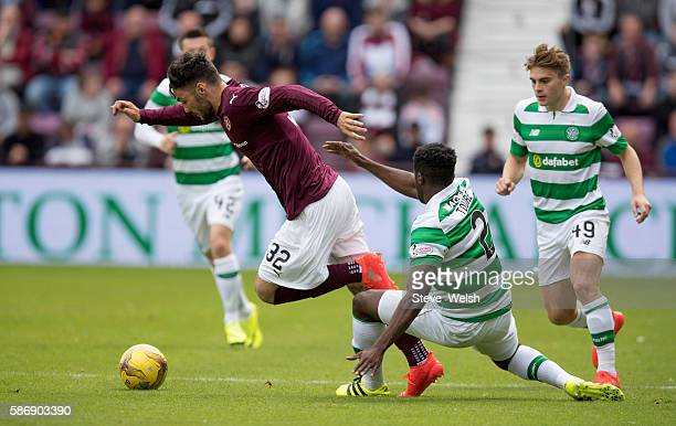Tony Watt of Hearts goes past Kolo Toure of Celtic during the Ladbrokes Scottish Premiership match between Hearts and Celtic on August 7 2016 in...