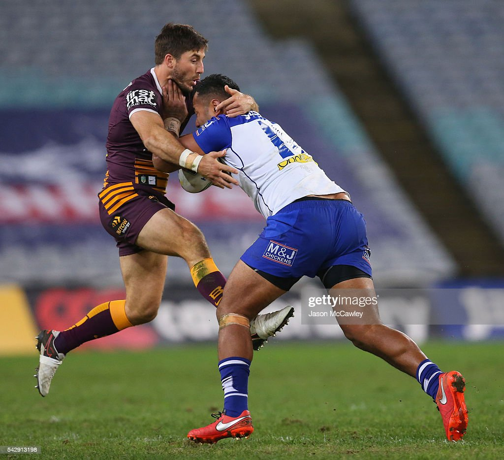 Tony Williams of the Bulldogs is tackled by Ben Hunt of the Broncos during the round 16 NRL match between the Canterbury Bulldogs and Brisbane Broncos at ANZ Stadium on June 25, 2016 in Sydney, Australia.