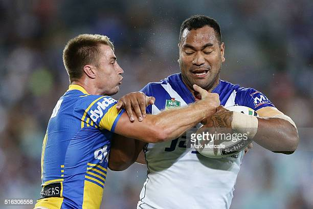 Tony Williams of the Bulldogs is tackled by Kieran Foran of the Eels during the round three NRL match between the Canterbury Bulldogs and the...