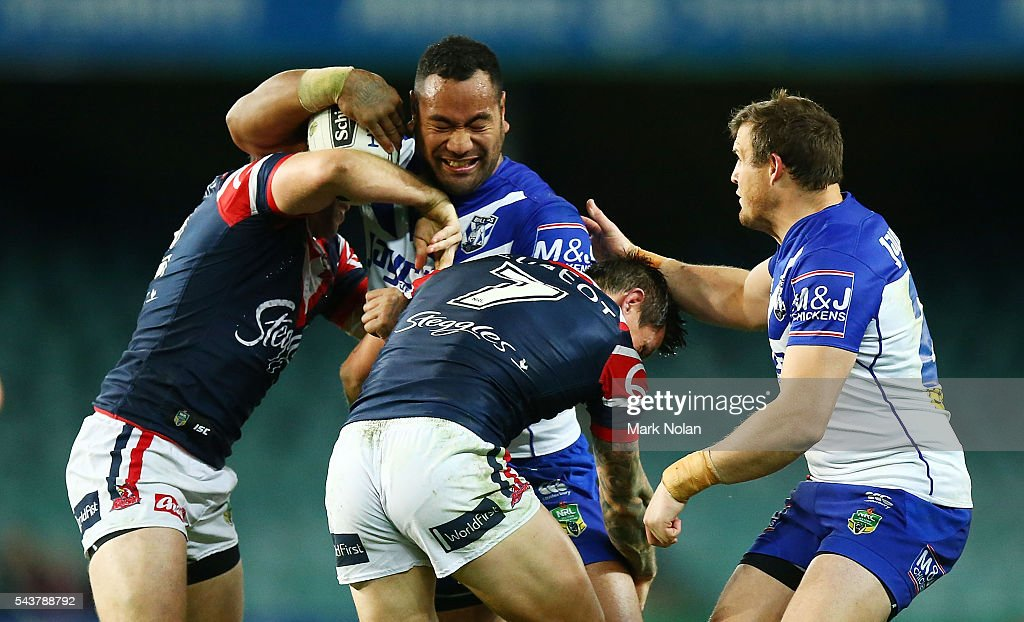 <a gi-track='captionPersonalityLinkClicked' href=/galleries/search?phrase=Tony+Williams+-+Rugby+Player&family=editorial&specificpeople=224594 ng-click='$event.stopPropagation()'>Tony Williams</a> of the Bulldogs is tackled during the round 17 NRL match between the Sydney Roosters and the Canterbury Bulldogs at Allianz Stadium on June 30, 2016 in Sydney, Australia.