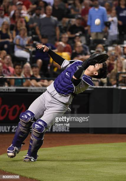 Tony Wolters of the Colorado Rockies catches a foul ball pop up behind home plate against the Arizona Diamondbacks at Chase Field on July 1 2017 in...