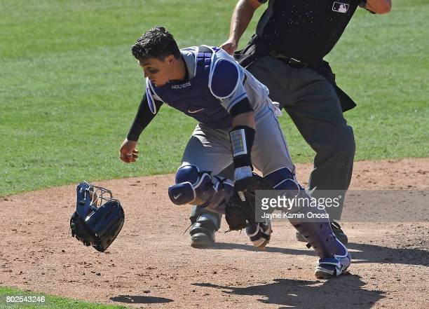 Tony Wolters of the Colorado Rockies chases down a wild pitch in the game against the Los Angeles Dodgers at Dodger Stadium on June 25 2017 in Los...