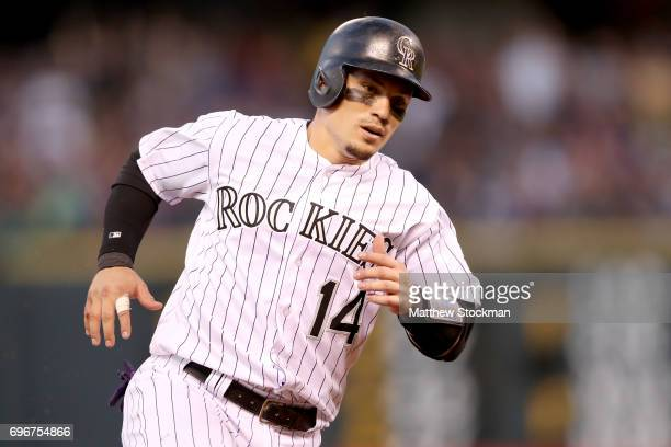 Tony Wolters of the Colorado Rockies circles the bases to score on a Chalrie Blackmon RBI triple in the fifth inning against the San Francisco Giants...