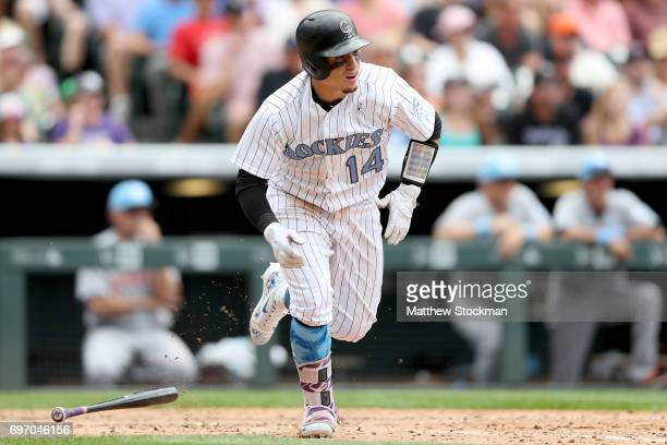 Tony Wolters of the Colorado Rockies hits a RBI single in the seventh inning against the San Francisco Giants at Coors Field on June 17 2017 in...