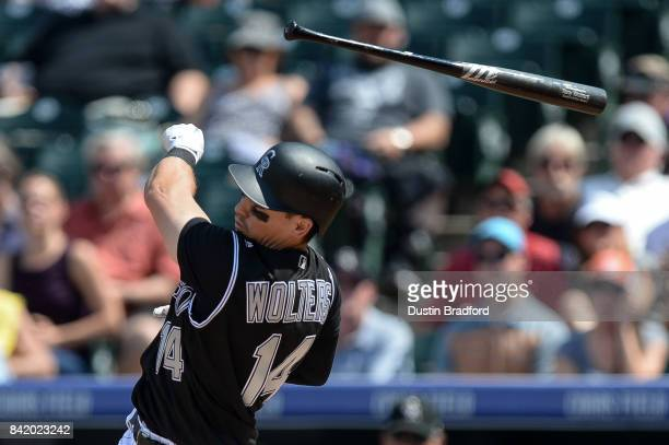 Tony Wolters of the Colorado Rockies loses his bat as he bats against the Detroit Tigers in the second inning of a game at Coors Field on August 30...