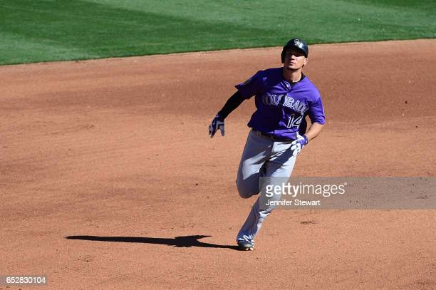 Tony Wolters of the Colorado Rockies runs the bases against the Arizona Diamondbacks during the spring training game at Salt River Fields at Talking...