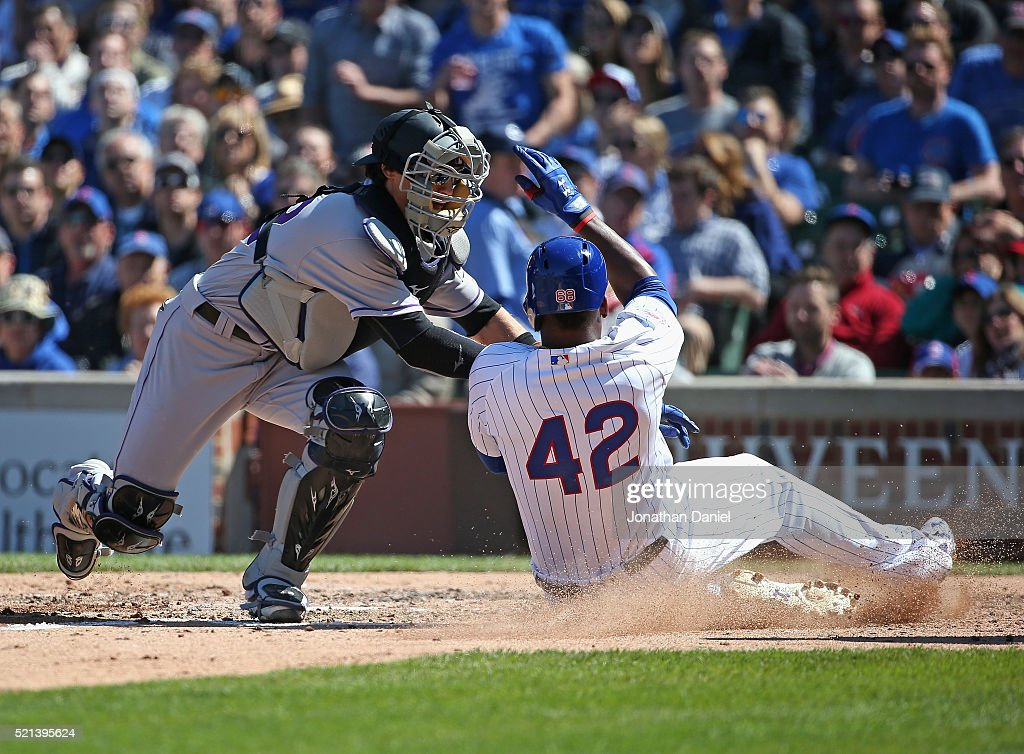 Tony Wolters of the Colorado Rockies tags out Jorge Soler of the Chicago Cubs at the plate in the 5th inning at Wrigley Field on April 15, 2016 in Chicago, Illinois. All players are wearing #42 in honor of Jackie Robinson Day.