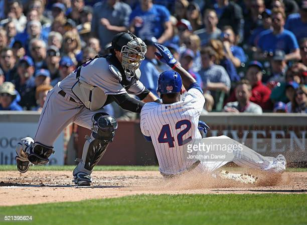Tony Wolters of the Colorado Rockies tags out Jorge Soler of the Chicago Cubs at the plate in the 5th inning at Wrigley Field on April 15 2016 in...
