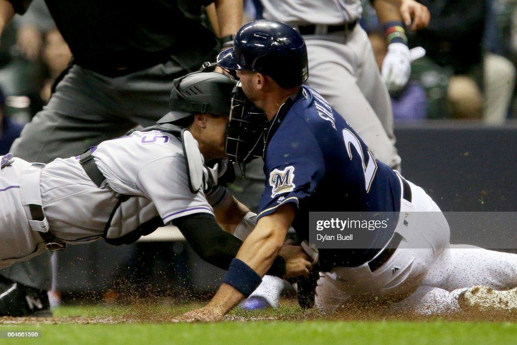 Tony Wolters #14 of the Colorado Rockies tags out Travis Shaw #21 of the Milwaukee Brewers during a collision at home plate in the fourth inning at Miller Park on April 4, 2017 in Milwaukee, Wisconsin.