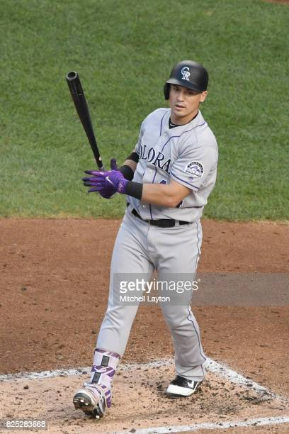 Tony Wolters of the Colorado Rockies takes a swing during a baseball game against the Washington Nationals at Nationals Park on July 29 2017 in...