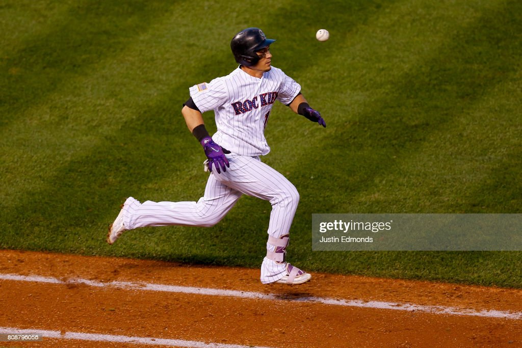 Tony Wolters #14 of the Colorado Rockies was unable to beat out the throw to first base after striking out for the second out of the seventh inning against the Cincinnati Reds at Coors Field on July 4, 2017 in Denver, Colorado. The Reds defeated the Rockies 8-1.
