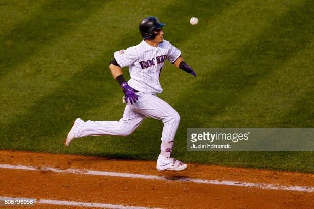 Tony Wolters of the Colorado Rockies was unable to beat out the throw to first base after striking out for the second out of the seventh inning...