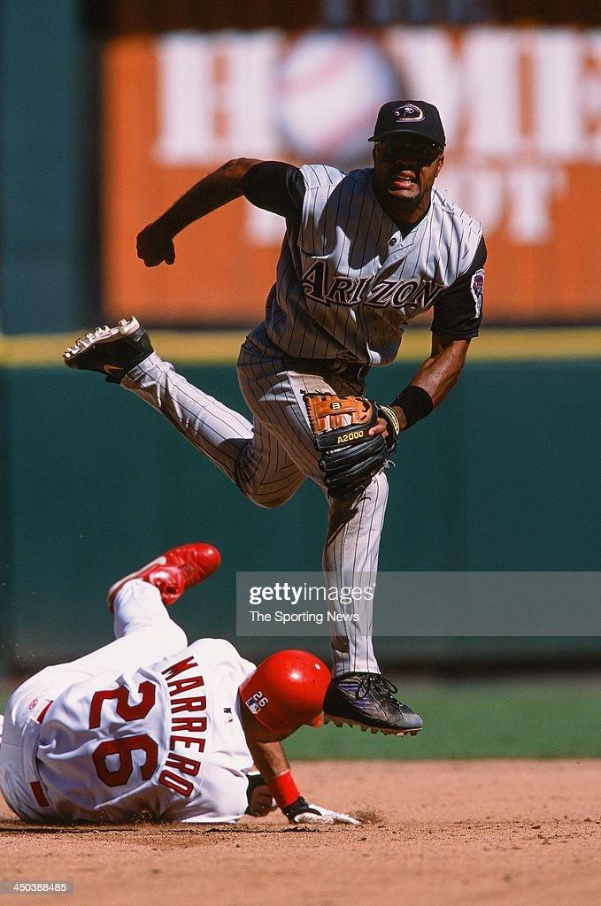Tony Womack of the Arizona Diamondbacks fields against Eli Marrero of the St Louis Cardinals at Busch Stadium on September 25 2002 in St Louis...