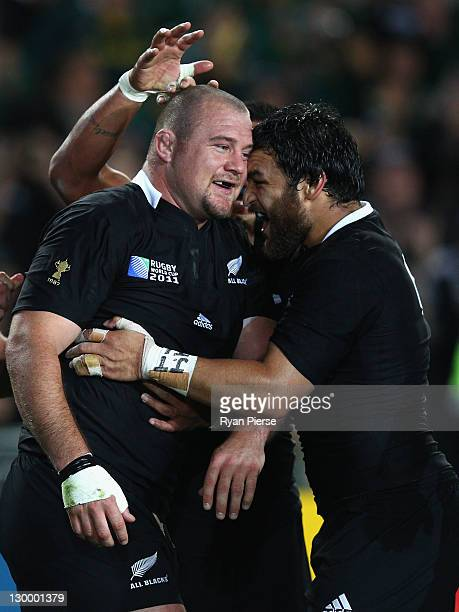 Tony Woodcock of the All Blacks celebrates scoring their first try with team mate Piri Weepu during the 2011 IRB Rugby World Cup Final match between...
