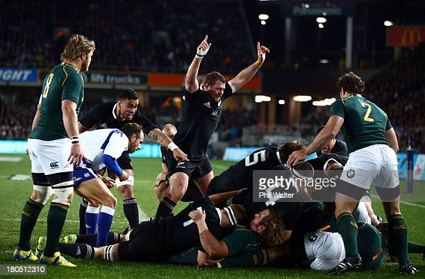 Tony Woodcock of the All Blacks celebrates the opening try from Kieran Read during The Rugby Championship match between the New Zealand All Blacks...