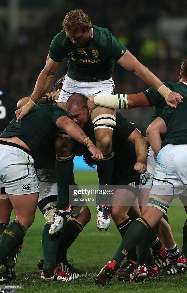 Tony Woodcock of the All Blacks lifts Andries Bekker of South Africa on his shoulders during the Rugby Championship match between the New Zealand All...