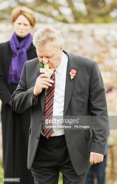 Tony Woodgate father of fallen serviceman Lance Corporal of the Horse Jonathan Woodgate kisses his cross before planting it in the Royal British...