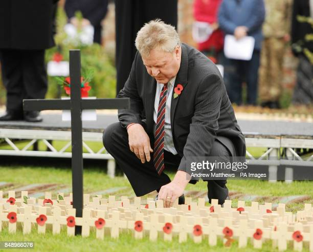 Tony Woodgate father of fallen serviceman Lance Corporal of the Horse Jonathan Woodgate plants his cross in the Royal British Legion's Afghanistan...