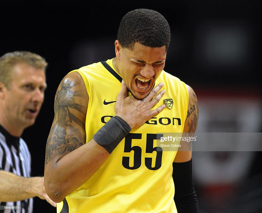 Tony Woods #55 of the Oregon Ducks reacts after being injures in the first half of the game against the Colorado Buffaloes at Matthew Knight Arena on February 7, 2013 in Eugene, Oregon.