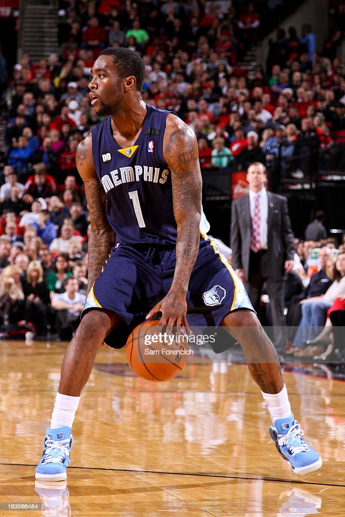 Tony Wroten #1 of the Memphis Grizzlies dribbles the ball between his legs against the Portland Trail Blazers on March 12, 2013 at the Rose Garden Arena in Portland, Oregon.
