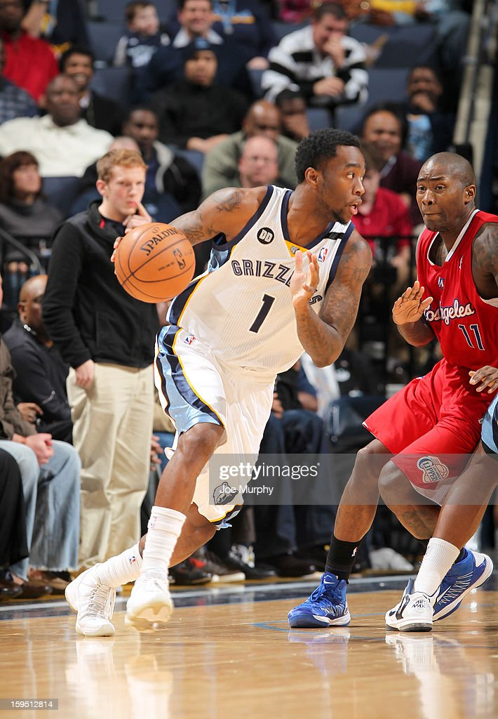 Tony Wroten #1 of the Memphis Grizzlies drives against Jamal Crawford #11 of the Los Angeles Clippers on January 14, 2013 at FedExForum in Memphis, Tennessee.