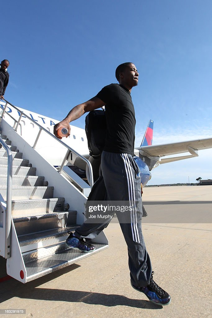 Tony Wroten #1 of the Memphis Grizzlies exits the team plane on March 2, 2013 at Orlando International Airport in Orlando, Florida.