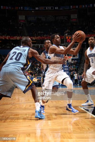 Tony Wroten of the Memphis Grizzlies goes to the basket against Quincy Pondexter of the Memphis Grizzlies on March 3 2013 at Amway Center in Orlando...