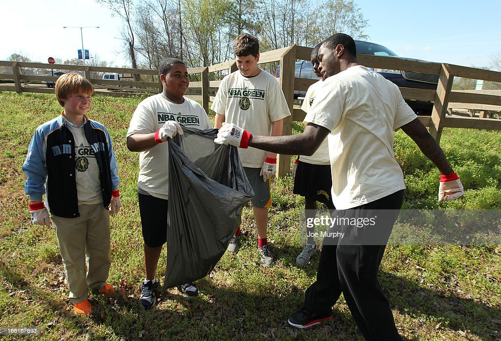Tony Wroten #1 of the Memphis Grizzlies helps clean up in conjunction with NBA Green Week on April 8, 2013 at the Wolf River Greenway in Memphis, Tennessee.