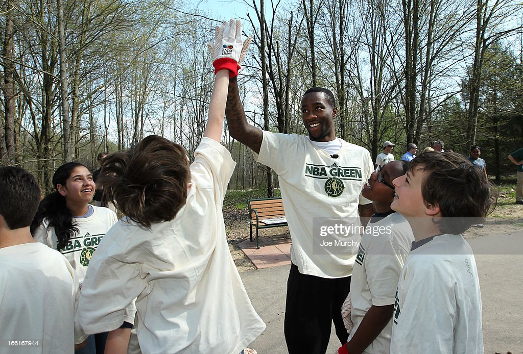 Tony Wroten #1 of the Memphis Grizzlies high fives children helping to clean up in conjunction with NBA Green Week on April 8, 2013 at the Wolf River Greenway in Memphis, Tennessee.