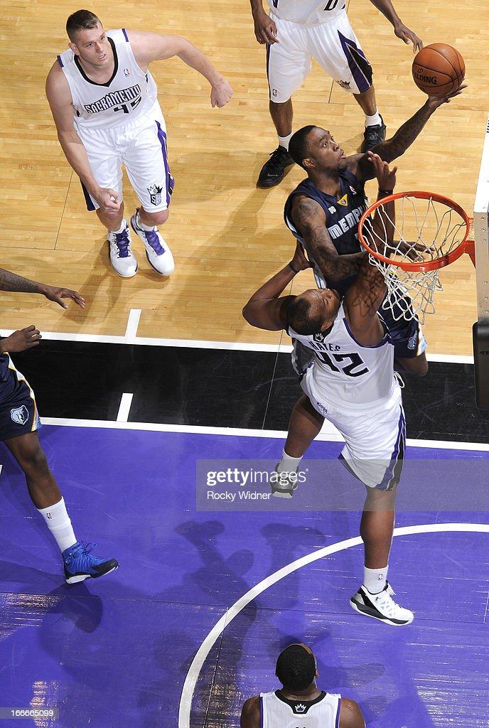 Tony Wroten #1 of the Memphis Grizzlies shoots against Chuck Hayes #42 of the Sacramento Kings on April 7, 2013 at Sleep Train Arena in Sacramento, California.