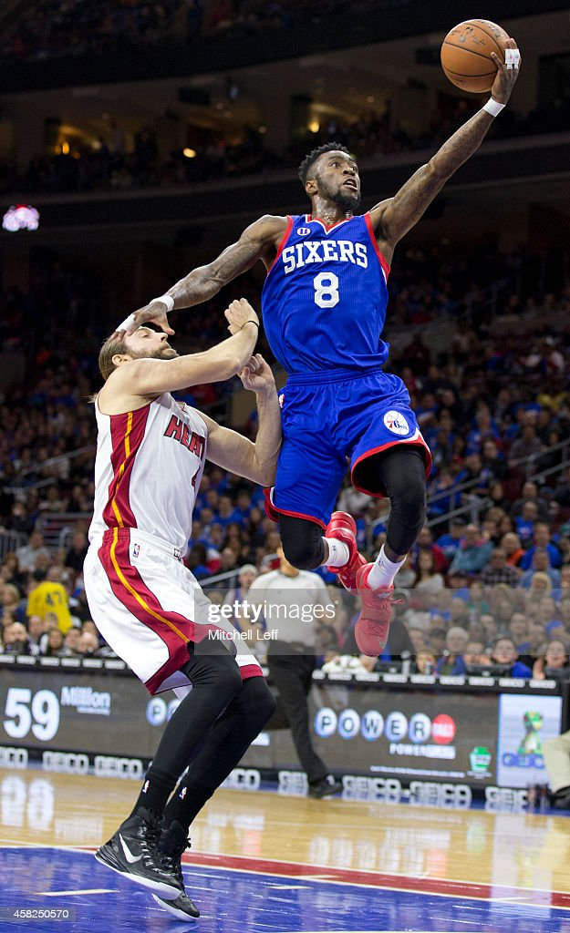 Tony Wroten #8 of the Philadelphia 76ers attempts a layup with Josh McRoberts #4 of the Miami Heat defending on the play on November 1, 2014 at the Wells Fargo Center in Philadelphia, Pennsylvania.