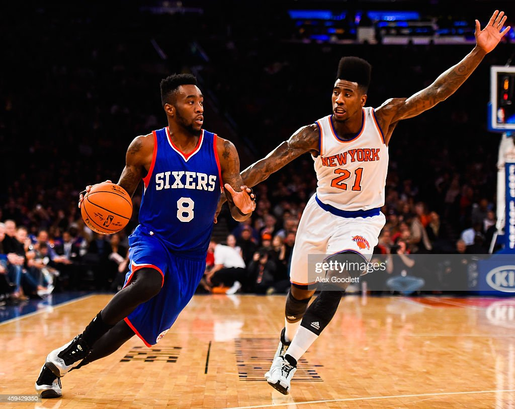 Tony Wroten of the Philadelphia 76ers attempts to drive past Iman Shumpert of the New York Knicks in the first half at Madison Square Garden on...