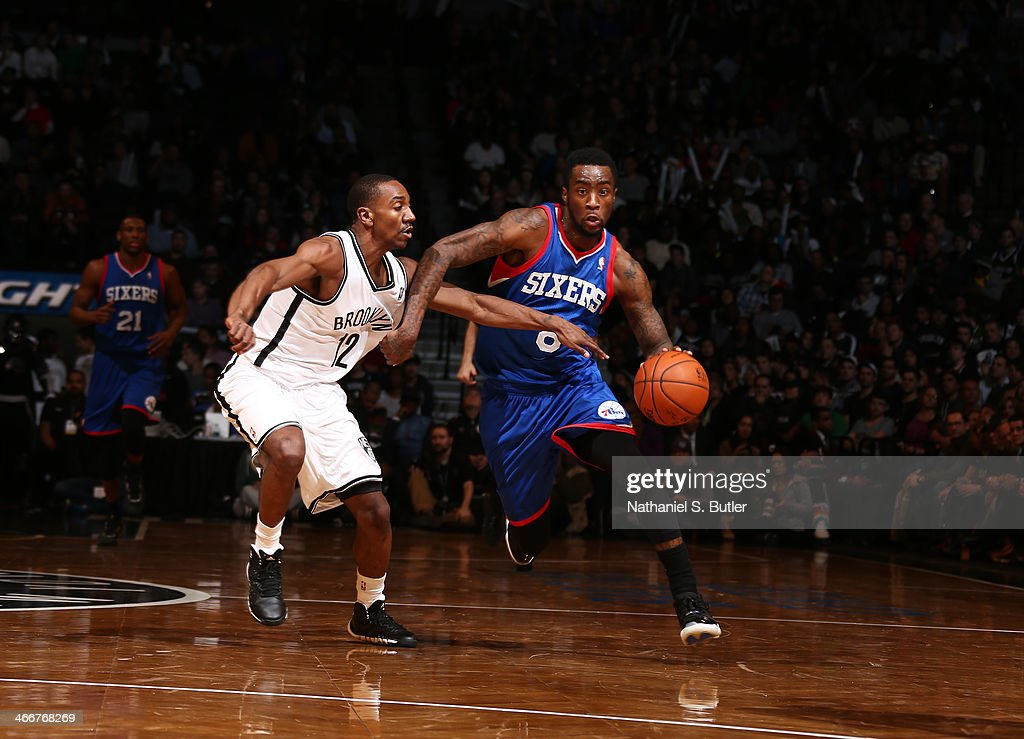 <a gi-track='captionPersonalityLinkClicked' href=/galleries/search?phrase=Tony+Wroten&family=editorial&specificpeople=7651920 ng-click='$event.stopPropagation()'>Tony Wroten</a> #8 of the Philadelphia 76ers drives against Marquis Teague #12 of the Brooklyn Nets during a game at Barclays Center in Brooklyn.