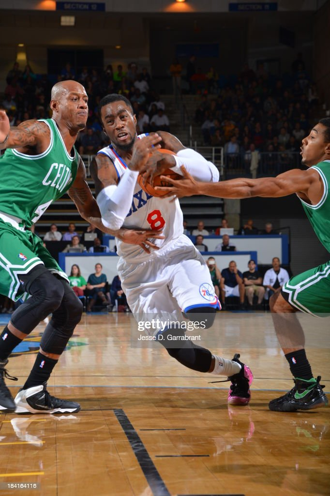 <a gi-track='captionPersonalityLinkClicked' href=/galleries/search?phrase=Tony+Wroten&family=editorial&specificpeople=7651920 ng-click='$event.stopPropagation()'>Tony Wroten</a> #8 of the Philadelphia 76ers drives to the basket against <a gi-track='captionPersonalityLinkClicked' href=/galleries/search?phrase=Keith+Bogans&family=editorial&specificpeople=202483 ng-click='$event.stopPropagation()'>Keith Bogans</a> #4 of the Boston Celtics at the Bob Carpenter Center on October 11, 2013 in Newark, Delaware.