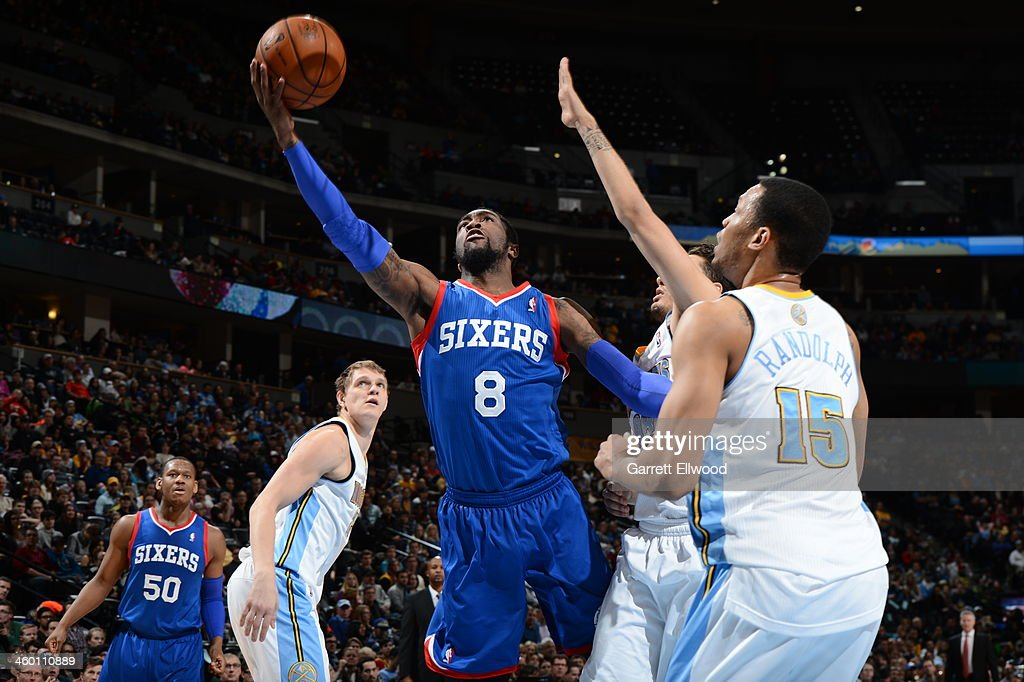 <a gi-track='captionPersonalityLinkClicked' href=/galleries/search?phrase=Tony+Wroten&family=editorial&specificpeople=7651920 ng-click='$event.stopPropagation()'>Tony Wroten</a> #8 of the Philadelphia 76ers drives to the basket against the Denver Nuggets on January 1, 2014 at the Pepsi Center in Denver, Colorado.