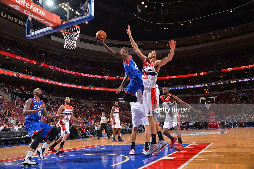 <a gi-track='captionPersonalityLinkClicked' href=/galleries/search?phrase=Tony+Wroten&family=editorial&specificpeople=7651920 ng-click='$event.stopPropagation()'>Tony Wroten</a> #8 of the Philadelphia 76ers drives to the basket against the Washington Wizards at the Wells Fargo Center March 1, 2014 in Philadelphia, Pennsylvania.